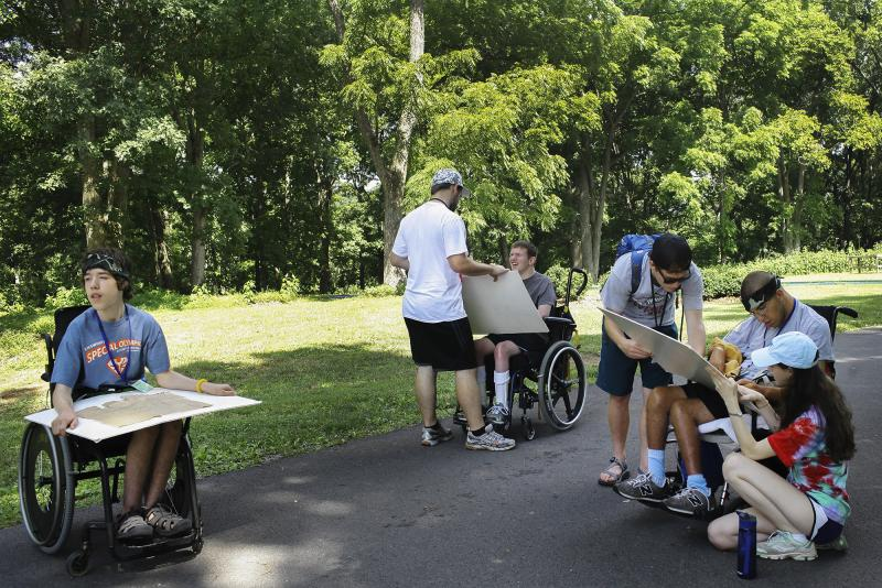 Counselors assist campers at making maps at the Center for Courageous Kids in Scottsville, Ky on Wednesday, July 2, 2014.