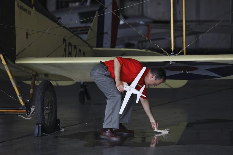 Aeronautics instructor, Kurt Jefferson of Lexington, retrieves a plane at Aviation Camp at the Bowling Green Regional Airport on Tuesday, July 8, 2014.