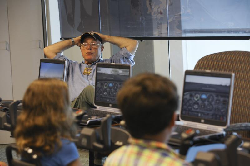 Jim Cagey, flight simulator instructor from Lexington, teaches campers at Aviation Camp at the Bowling Green Regional Airport on Tuesday, July 8, 2014.