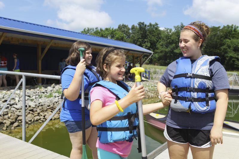 Campers and a counselor prepare to canoe at the Center for Courageous Kids in Scottsville, Ky on Wednesday, July 2, 2014.