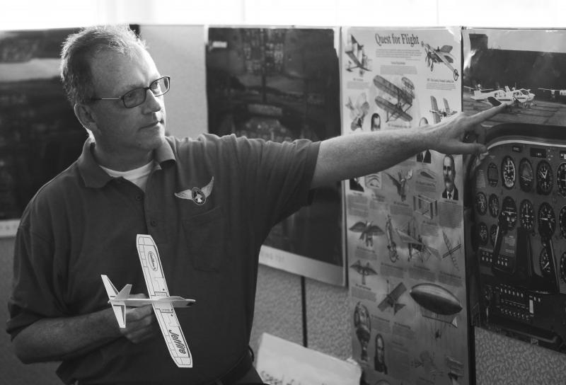 Aeronautics instructor, Kurt Jefferson of Lexington, teaches campers about different types of planes at Aviation Camp at the Bowling Green Regional Airport on Tuesday, July 8, 2014.
