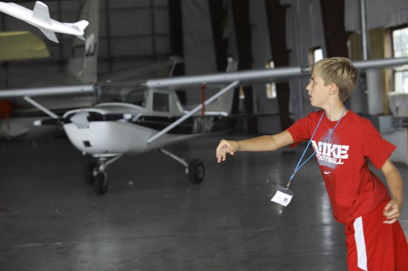 Will Simms, 12 of Bowling Green, tosses a styrofoam airplane at Aviation Camp at the Bowling Green Regional Airport on Tuesday, July 8, 2014.