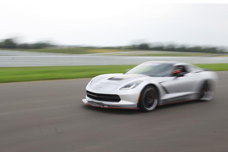 A Corvette owner drives around the new track at the National Corvette Museum Motorsports Park Thursday, August 28, 2014. The track opened Thursday morning and accompanied a weekend full of festivities for Corvette owners and enthusiasts.
