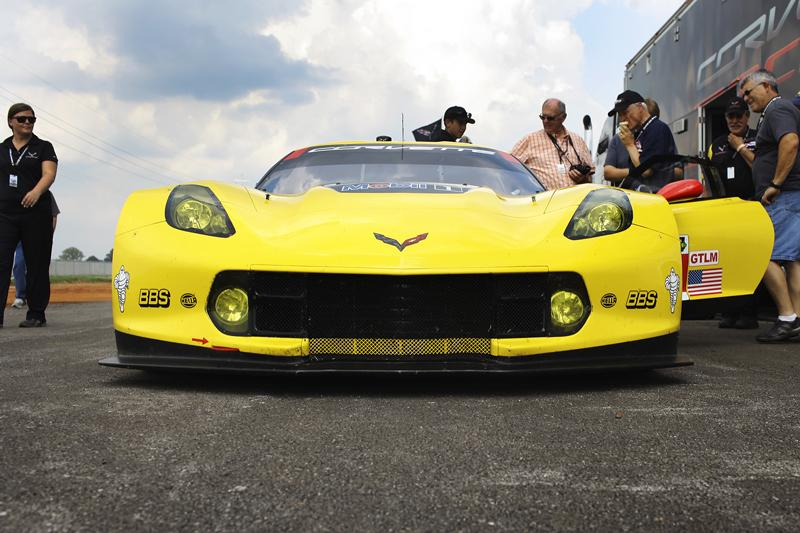 The Corvette C7.R race car is parked near the track at the National Corvette Museum Motorsports Park Thursday, August 28, 2014. The C7.R took a couple laps around the track before the event was cut short due to rain.