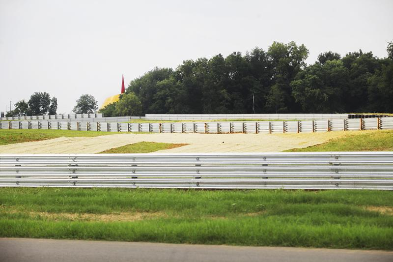 The top of the Corvette Museum can be seen from the new National Corvette Museum Motorsports Park Thursday, August 28, 2014. The track opened Thursday morning and accompanied a weekend full of festivities for Corvette owners and enthusiasts.