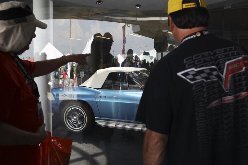 People outside the Corvette Museum check out a Corvette Thursday, August 28, 2014. The National Corvette Museum Motorsports Park opened Thursday morning and accompanied a weekend full of festivities for Corvette owners and enthusiasts.