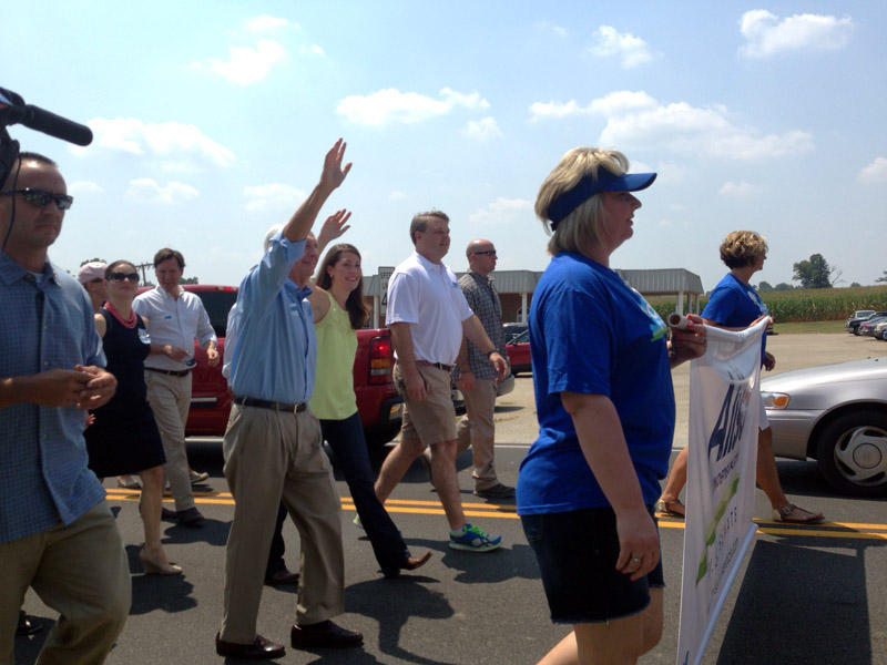 U.S. Senate candidate Alison Lundergan Grimes leads a procession into the St. Jerome's Parrish Grounds along with Gov. Steve Beshear