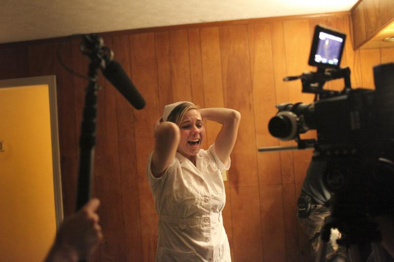 Jordan Price rehearses screaming on the set of The Milkman, a film by WKU student Amber Langston, in Bowling Green, KY on Sunday, October 26, 2014.
