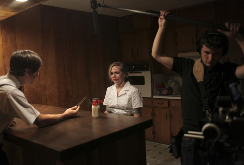 Jordan Price rehearses a scene on the set of The Milkman, a film by WKU student Amber Langston, in Bowling Green, KY on Sunday, October 26, 2014.