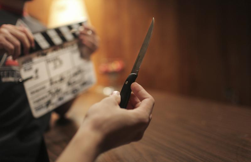 Trevor Peden plays with his prop knife on the set of The Milkman, a film by WKU student Amber Langston, in Bowling Green, KY on Sunday, October 26, 2014.