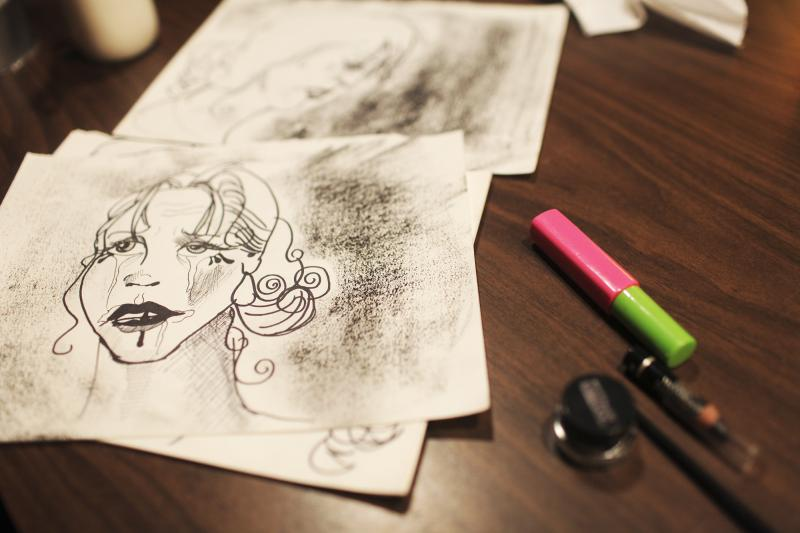 A drawing of how the actor's hair and makeup should look sits next to some makeup on the set of The Milkman, a film by WKU student Amber Langston, in Bowling Green, KY on Sunday, October 26, 2014.