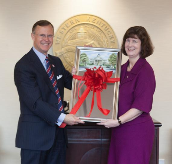 WKU President Gary Ransdell presents Dr. Patti Minter with a gift on her final day as Faculty Regent.