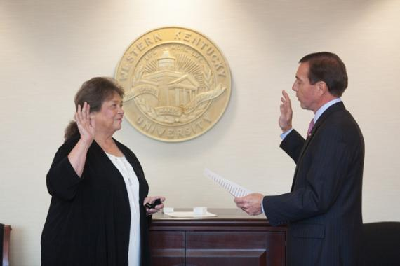 Dr. Barbara Burch is sworn in as WKU's new Faculty Regent by the Regents Chairman, David Potter