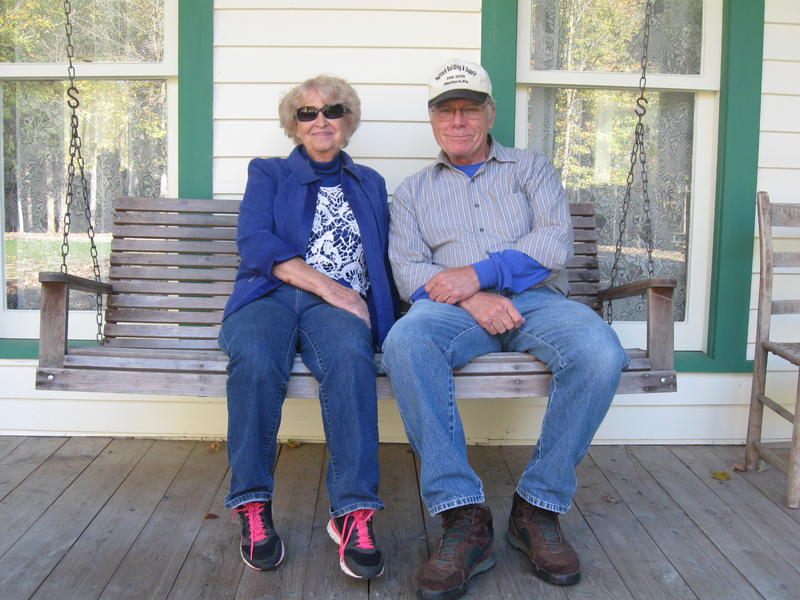 Monroe relative Merlene Austin and former bandmate Tom Ewing sit on the front porch of the Bill Monroe Homeplace.