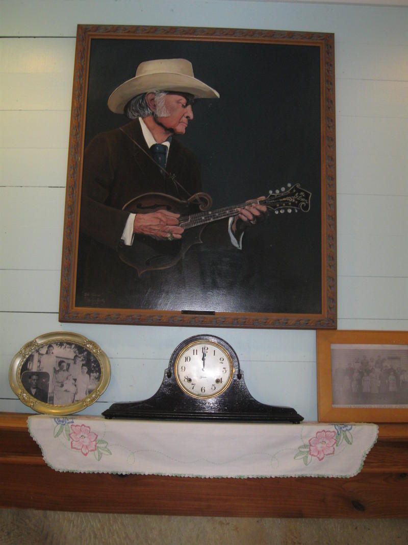 A portrait of Bill Monroe hangs above the fireplace in the Monroe Homeplace in Ohio County.