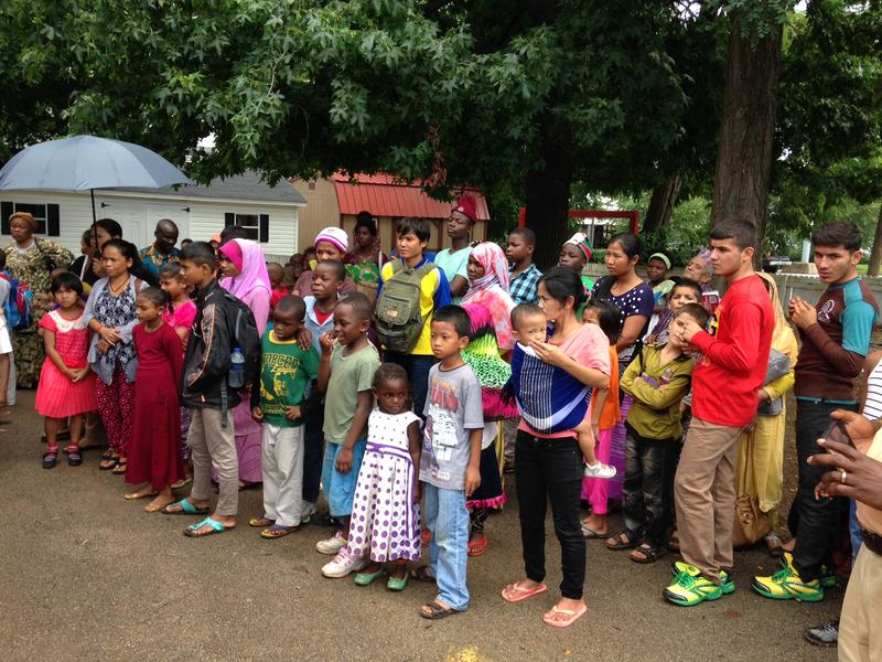 Refugees living in Bowling Green wait to receive school supplies Thursday.