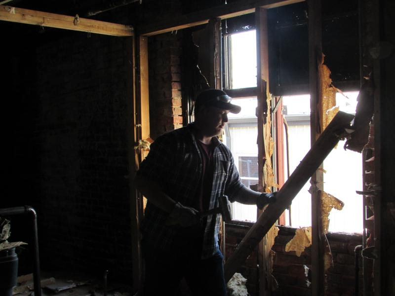 GO FAME apprentice Walker Hohiemer works on a renovation project at Sun Windows in Owensboro.
