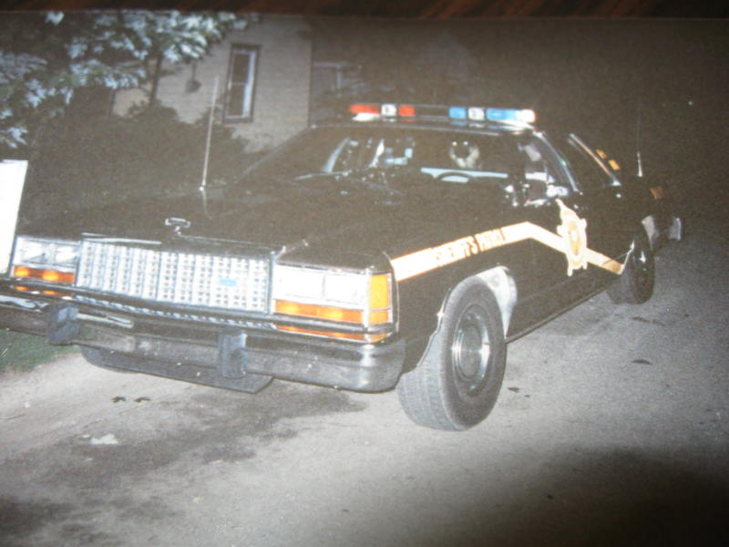 Former Daviess County Sheriff's Deputy David Osbourne's cruiser was parked at the home of Darrell Perry on May 27, 1989.