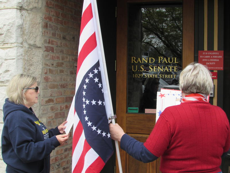 Some activists wait outside Senator Rand Paul's Bowling Green office.