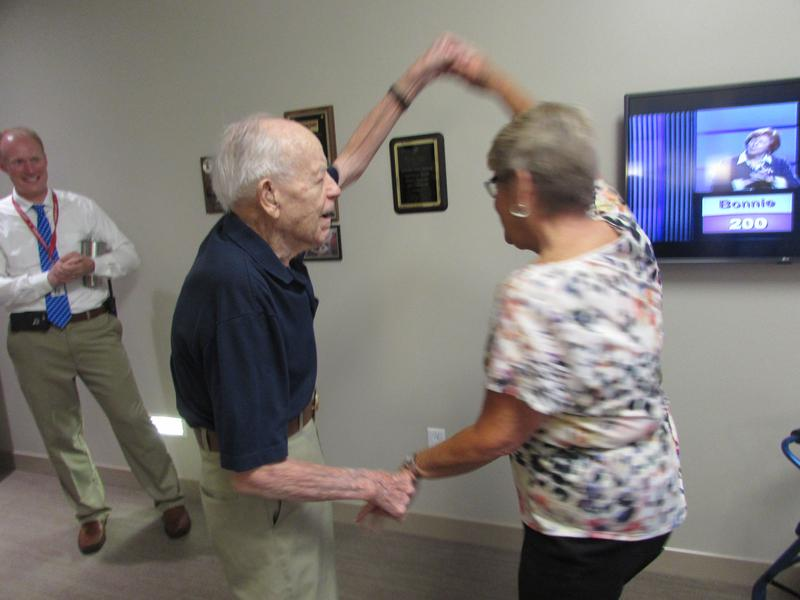 Radcliff Veterans Center resident William Wester, who is 101 years old, enjoys some of his ballroom dancing skills with his niece, Pam Panter of Louisville. At left is Administrator Israel Ray.
