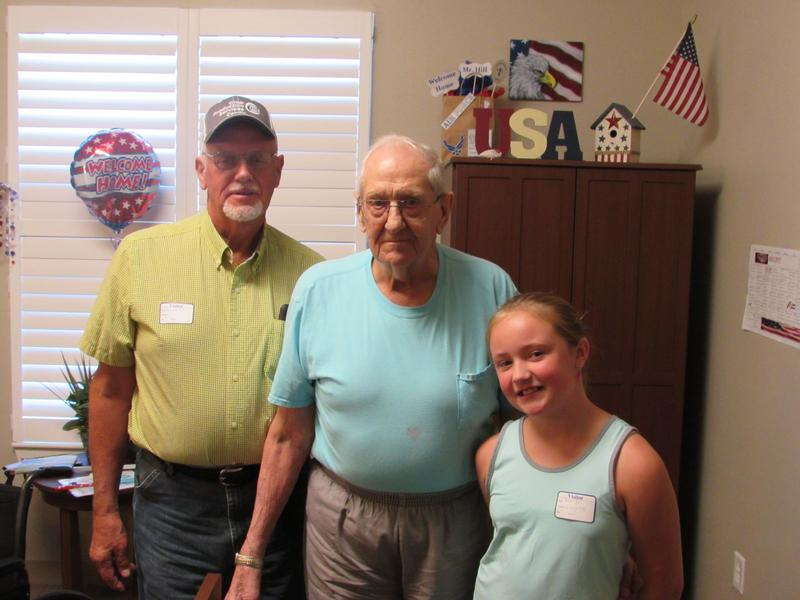 Radcliff Veterans Center resident Eugene Hill, center, with his son Gerald Hill, left, and great-granddaughter Ashtyn Lush.