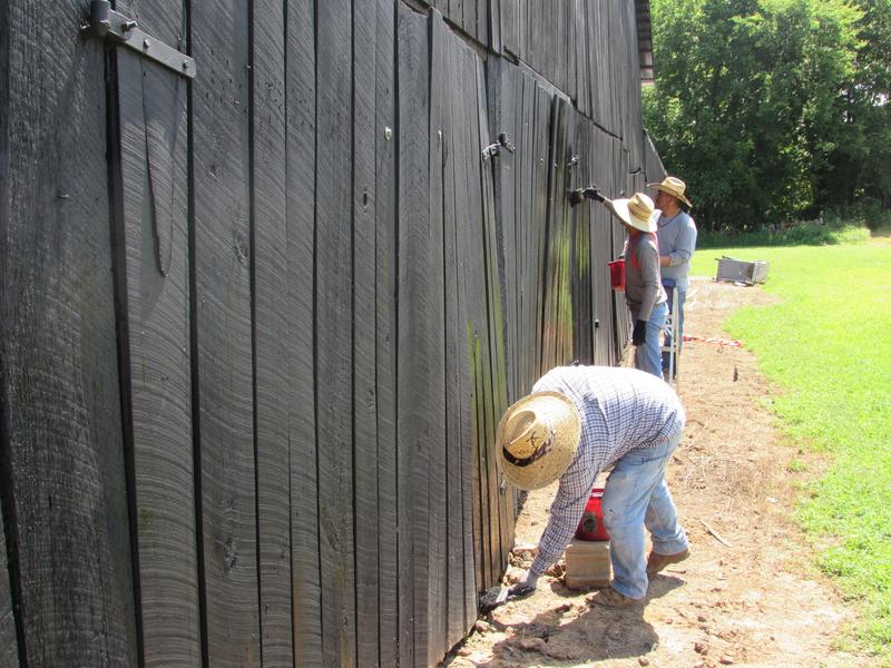 Painting at Phil and Jan Holliday's farm are, front to back, Misael Tabullo, Jonathan Aldana Sanchez and Edgar  Sanchez.