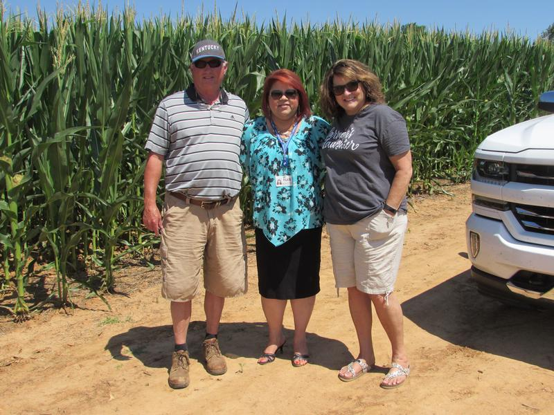 Phil Holliday with interpreter Mayra Duncan of the Logan County Migrant Education Program, and at right, Jan Holliday.