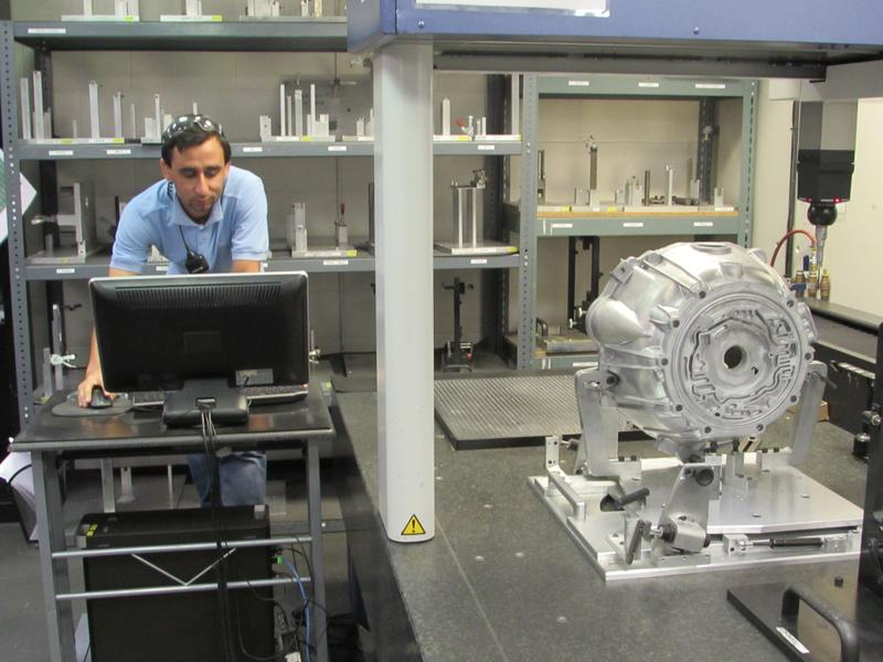 Mohammad Jawid, a quality control team leader at Trace Die Cast, works on the computer system that manages the precision manufacturing of engine and transmission components.