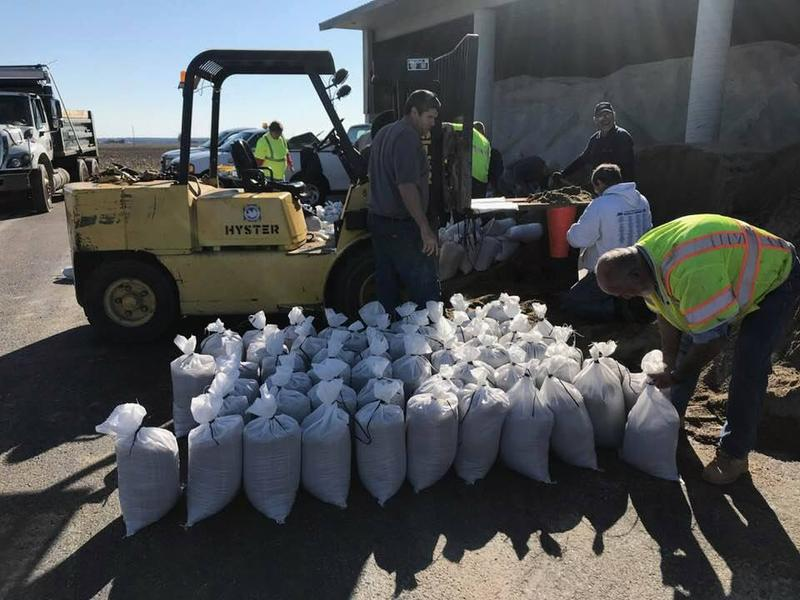 Volunteers fill sand bags at the Daviess County Operations Center on Calhoun Rd.