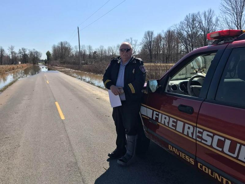 Harvey Henderson with the Daviess County Fire Department surveyed the flooded Millers Mills Rd.
