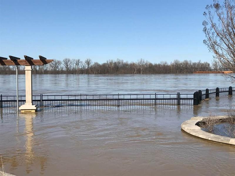 Smokers Park, which includes a live entertainment area, walkway, and playground is under water from the flooded Ohio River.