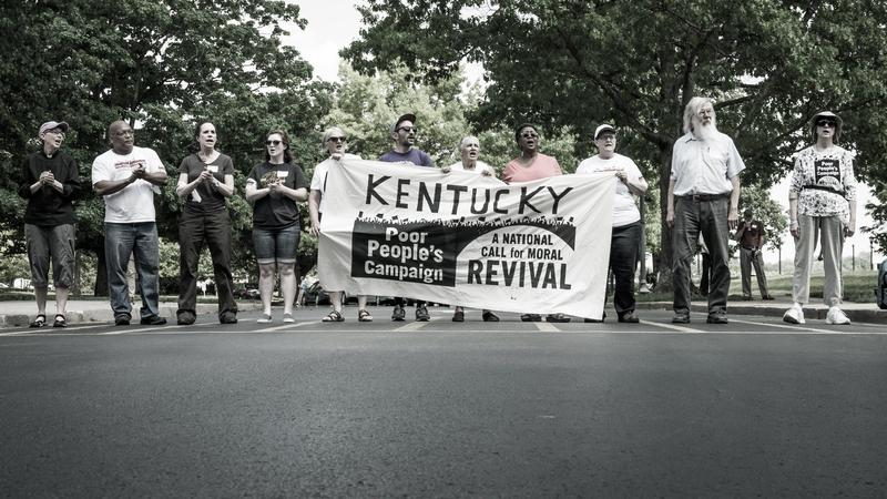 Kentuckians march in Frankfort to speak out against issues including racism and poverty on May 14, 2018.