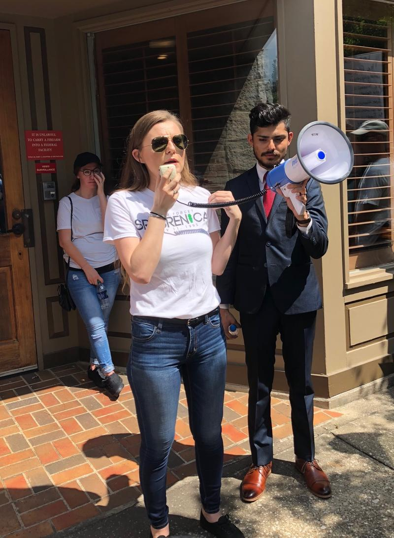Bosnian immigrant Sabina Husic sharing her story to crowd at Families Belong Together rally.