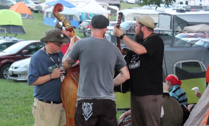 A group of musicians jams near the camping area at ROMP, June 30, 2018