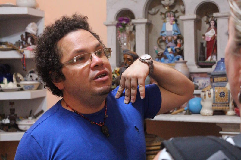 Elias guides a tour through a Santera's house in Havana