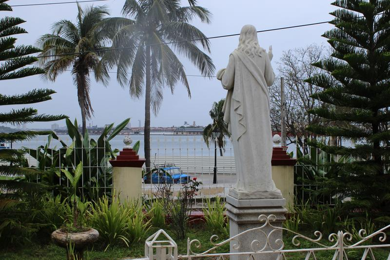 The early 1990s brought a softening of the Cuban government's stance toward religion. Here, we see a statue outside a church in the Regla neighborhood