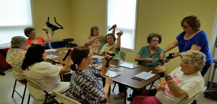 Participants use the Bingocize mobile app on tablets at a program in Larue County, Kentucky.