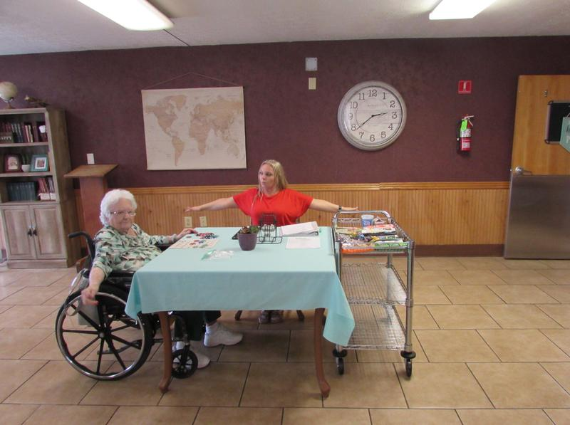 Activities Assistant Michelle Cline and one of the residents at Greenwood Nursing and Rehabilitation Center during Bingocize.