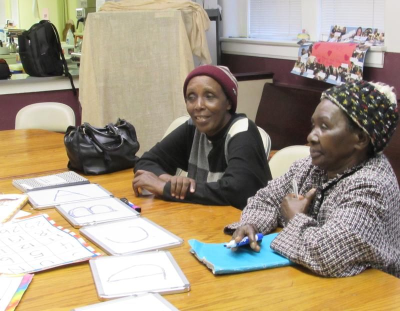 Refugees taking part in an English lesson are , Namagishu Namahoro, left, and Kwirina Ngeze.