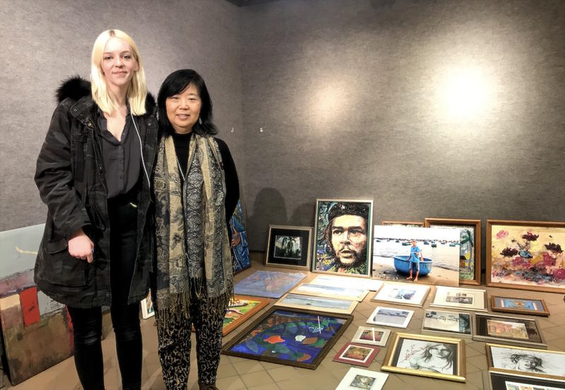 Victoria Layne and Miwon Choe prepare a new exhibit of Cuban artwork at Western Kentucky University