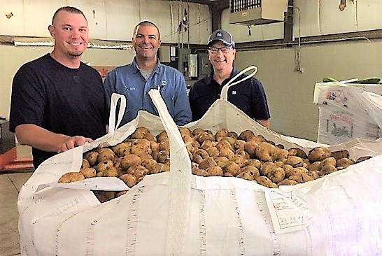 A large shipment of potatoes arrives at Feeding America Kentucky's Heartland.