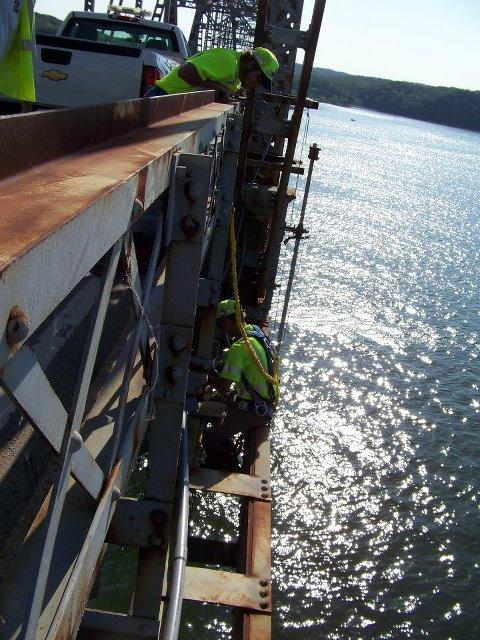 Workers on the job at Eggners Ferry Bridge