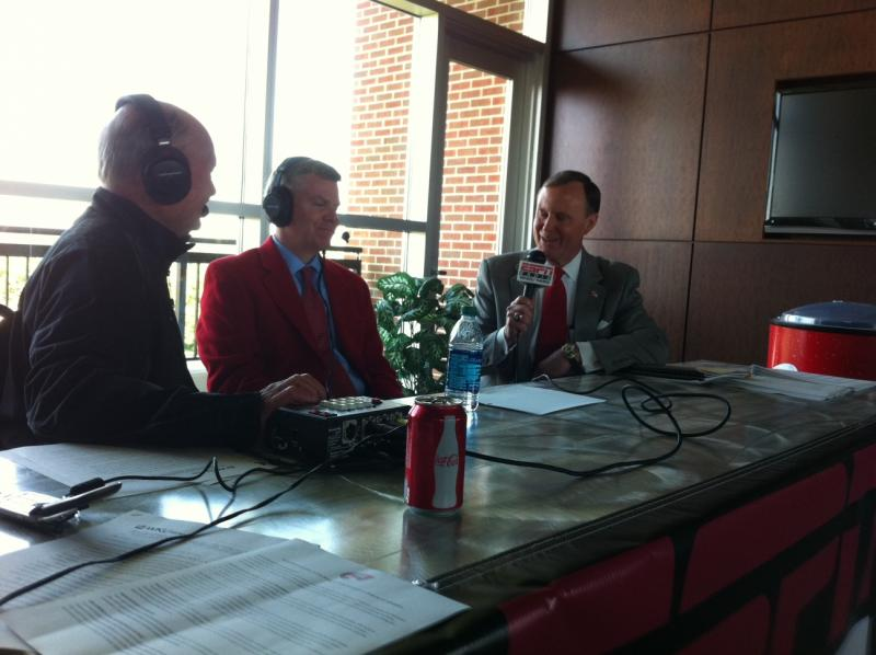 WKU Athletics Director Todd Stewart (middle), and WKU President Gary Ransdell (right) speak to a radio reporter