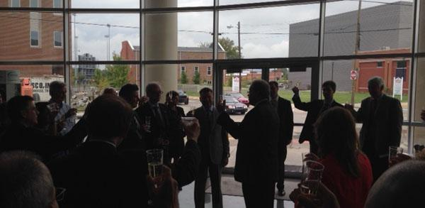 Municipal leaders, company executives and area business leaders toast the arrival of The Bilstein Group in Bowling Green