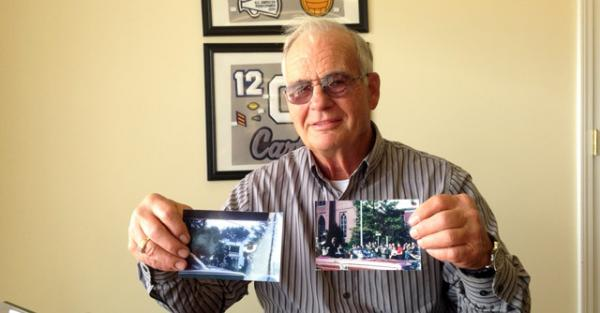 Gerald Givens displays the two photos he took during John F. Kennedy's 1960 campaign appearance in Bowling Green.