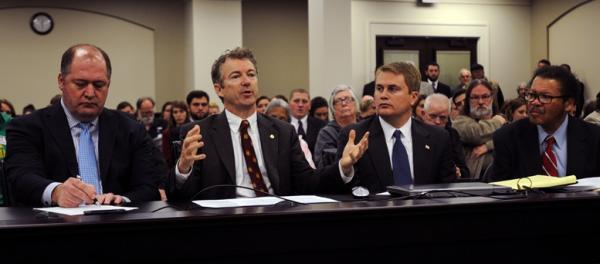 State Rep. Jesse Crenshaw (seated far right) listens as U.S. Senator Rand Paul last month spoke on behalf of a bill that would restore voting rights to certain felons