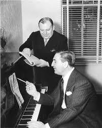Harry Warren (at piano) and Al Dubin (standing) at work on another music composition.  Music by Harry Warren was spotlighted in The Feeling of Jazz, Program Number 99, originally airing 09-30-2012 and rebroadcast 01-22-2017.