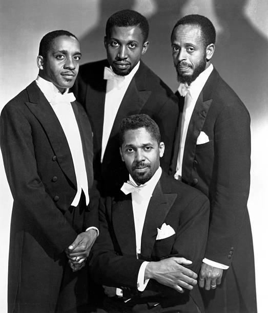 Photo of MODERN JAZZ QUARTET; Milt Jackson, Connie Kay, John Lewis and Percy Heath in formal tuxes.