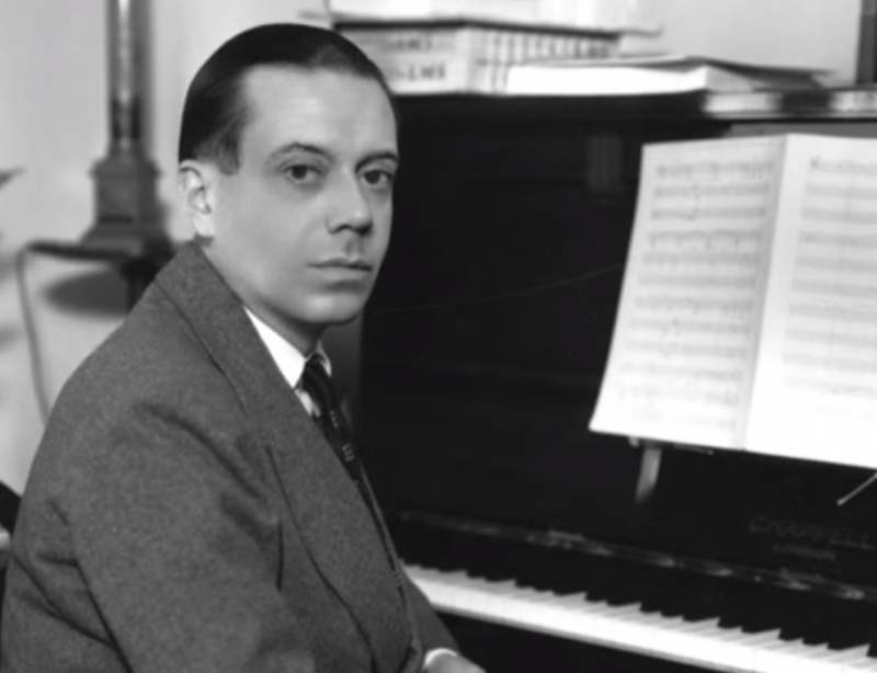 American composer Cole Porter at piano.
