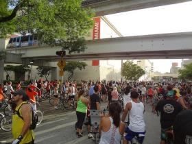 Cyclists gather for a Critical Mass ride at Government Center in Downtown Miami.